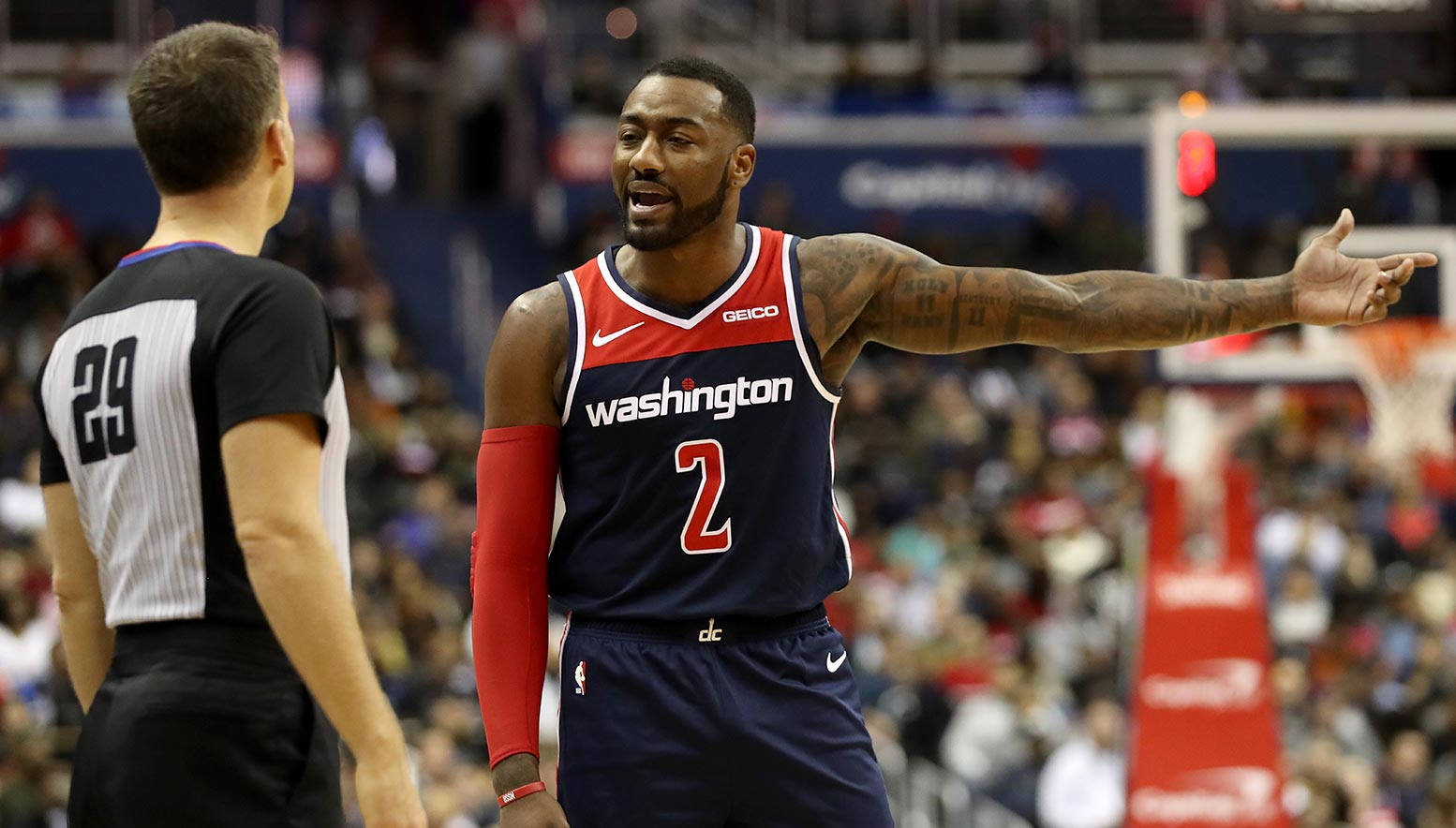John Wall argues with ref